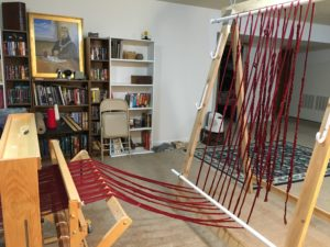 warping trapeze - warp draped over the trapeze - under the bottom bar and over the top bar