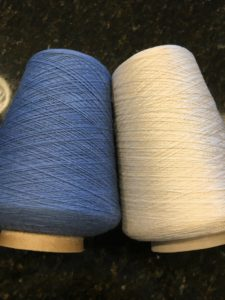 weaving fibers: blue wool for the weft and white silk for the warp